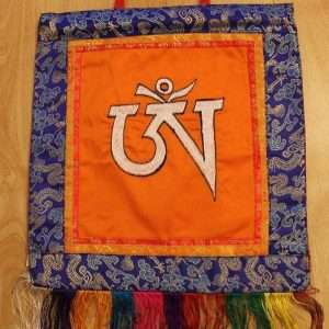OM symbol wall hanging (white on orange)