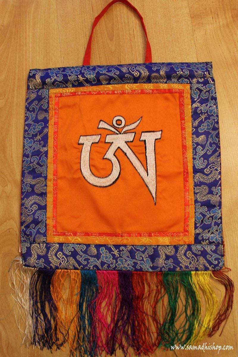 OM symbol wall hanging (white on orange)