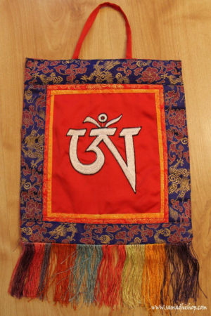 OM symbol wall hanging (white on red)