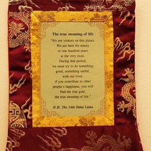 Dalai Lama True Meaning Of Life Wall Hanging (purple color)