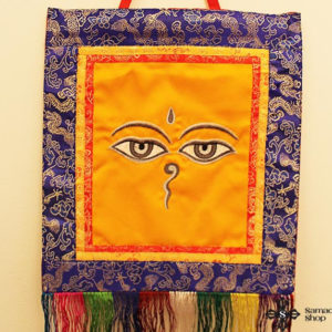 Wisdom Eyes of Buddha Wall Hanging (silver eyes on orange background)